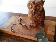 An unfinished owl sculpture product.